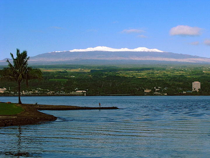 Peaceful Hilo Bay with a snow-capped Mauna Kea in the background. Photo courtesy of Keoni Dibelka.